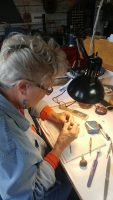 Janet carving the Humpback Whale ring out of wax.