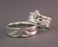 Photo of the Handcarved Signature Wedding Rings by Owen Walker
