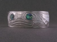Photo of Sterling Silver hand carved Frog bracelet with abalone inlaid eyes