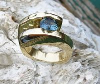 Custom Ocean Blue Sapphire Story Ring with Diamond bubbles