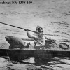 Archival photo of Inuit hunter in Kayak with Harpoon