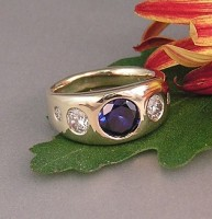 A sapphire and 5 diamonds in a 14kt Recycled Memorial Ring