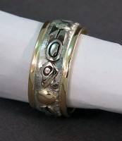 Photo of two color Gold Lovebirds wedding band