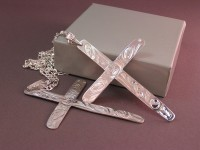 photo of Sterling silver hand engraved crosses