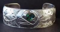 photo of Hand carved Sterling Silver profile Octopus bracelet D42