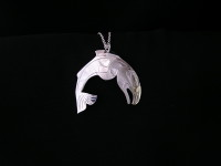 Jumping salmon pendant hand carved in sterling silver by Owen Walker