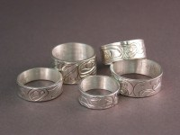 Collection of Handcarved Sterling Silver Northwest Totem Design Rings made by Owen Walker