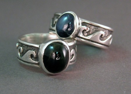 Photo of two surfer rings with cabachon stones