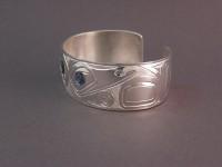 Photo of The Sassy Raven handcarved sterling silver bracelet