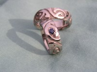 Photo of Walker Goldsmiths Polynesian Style Surfer Rings with dark blue Sapphire