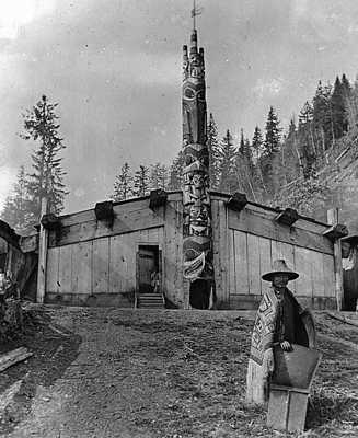 Photo of a Haida house at Tanu