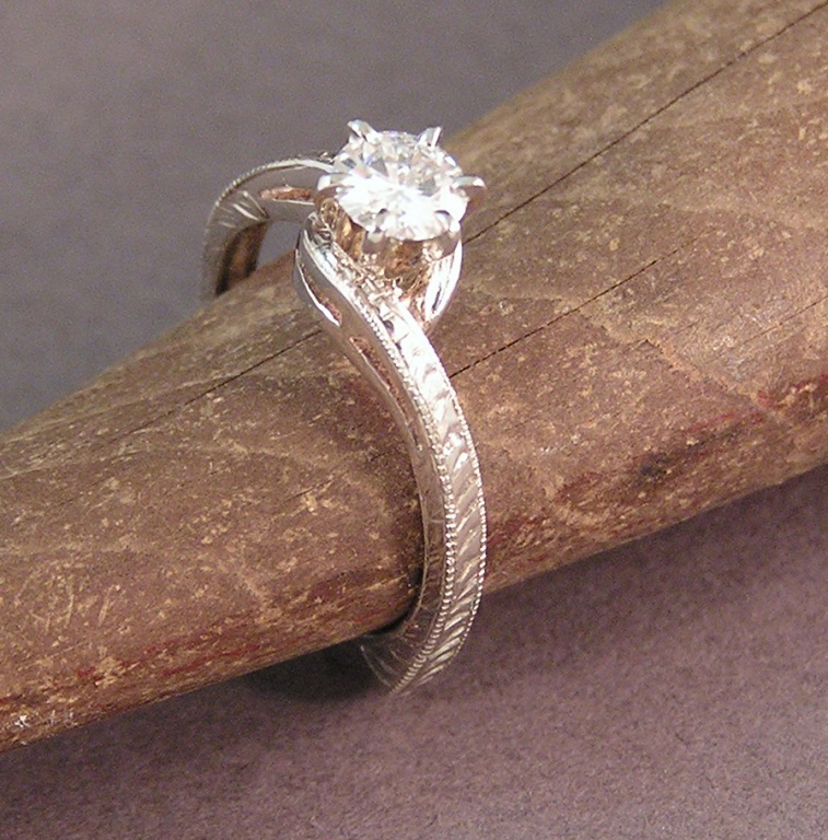 Hand carved 14kt White Gold ring with a ½ ct. center stone by Owen ...